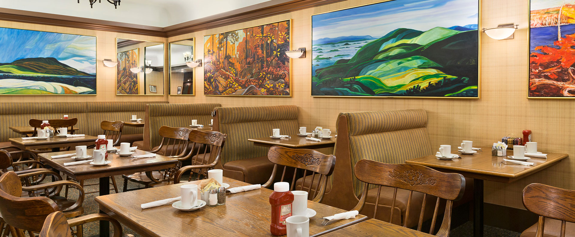 Chelsea's Restaurant, the onsite restaurant at Days Inn Vancouver Downtown is decorated with plush booths, leather seating and large colorful paintings.